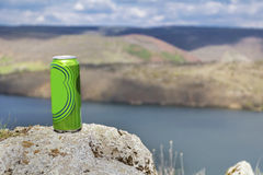 Cold can of beer on a lake background Stock Image