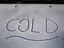 Cold Car Hood. Frosty engine bonnet of a car marked with the appropriate word cold stock image