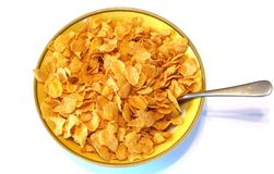 Cold cereal. Bowl of corn flakes on white background Stock Images