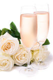 Cold champagne and a bouquet of roses Royalty Free Stock Photos