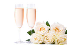 Cold champagne and a bouquet of roses Stock Photo