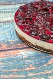 Cold cheesecake with cherry jelly on table Royalty Free Stock Photo