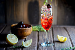 Cold cherry cocktail in glass with ice cubes with a shadow Royalty Free Stock Images