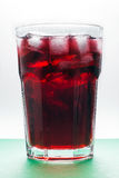 Cold cherry juice with ice cubes Stock Image