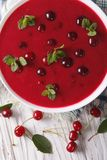 Cold cherry soup in a bowl on a table close-up. vertical top vie Royalty Free Stock Images