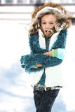 Cold Child in Snow Storm. Freezing cold seven year old girl standing in snow storm without coat royalty free stock photos