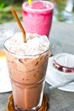 Cold chocolate. And mixed berry smoothie with cake in garden Royalty Free Stock Photography