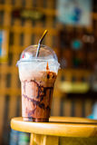 Cold chocolate drink in plastic cup Royalty Free Stock Photos