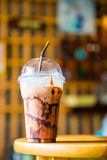 Cold chocolate drink in plastic cup Stock Photos
