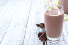 Cold Chocolate Milk. Drink (close-up shot) on wooden background Royalty Free Stock Image