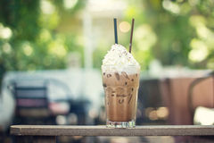 Cold chocolate with whipped cream topping in glass on summer nat Royalty Free Stock Photography