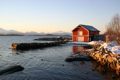 Cold Christmas in Norway. The view from the veranda on our seahouse rented in Molde. It was minus 16C, but the sun was shining, and the light beautiful. This red Stock Images