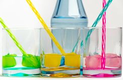 Cold, clean water in rainbow colored glasses stock photography