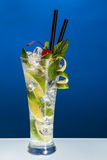 Cold cocktail. Ice cold mojito cocktail on blue background stock photos