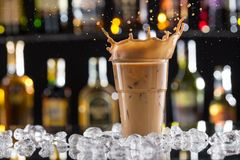 Cold coffee drink with ice, beans and splash Royalty Free Stock Images