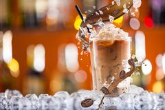 Cold coffee drink with ice, beans and splash Stock Photo
