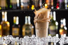 Cold coffee drink with ice, beans and splash Stock Images