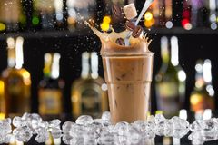 Cold coffee drink with ice, beans and splash Royalty Free Stock Photo