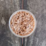 Cold coffee drink with ice on old wood Stock Images