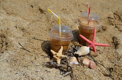 Cold coffee frappes on beach Royalty Free Stock Photo