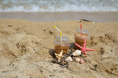 Cold Coffee Frappes Set on Beach Stock Images