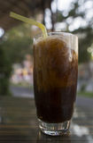 Cold coffee with ice cream. Coffee iced coffee in a glass beaker on the table Stock Image