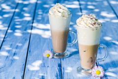 Cold coffee with ice Stock Images