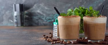 Cold coffee latte with chocolate. On a brown background royalty free stock photography