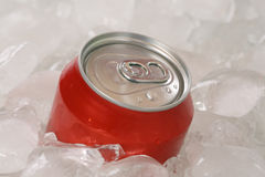 Cold cola in a can on ice cubes Royalty Free Stock Photos