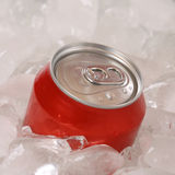 Cold cola drink in a can on ice cubes Royalty Free Stock Photos