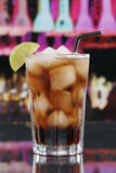 Cold cola in glass in a bar or party Royalty Free Stock Image