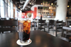 Cold Cola on wood background Stock Photos