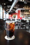 Cold Cola on wood background Stock Image