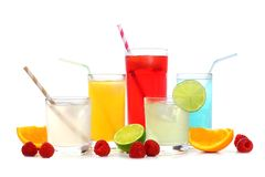 Cold colorful summer drinks with fruit isolated on white. Group of cold colorful summer drinks with fruit isolated on a white background Royalty Free Stock Photo