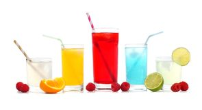 Cold colorful summer drinks with fruit isolated on white. Group of cold colorful summer drinks with fruit isolated on a white background Stock Image