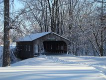 Cold Covered Bridge. A covered bridge in Centennial Park in Plymouth Indiana. The picture is taken after significant amount of snowfall Stock Photo