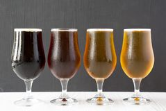 Cold craft beer assortment, side view. Close-up.  royalty free stock photos