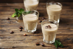 Cold cream with coffe and mint on the wooden table Stock Photos