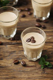 Cold cream with coffe and mint on the wooden table. Selective focus Royalty Free Stock Photos