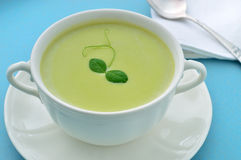 Cold creamy green pea soup. Summer meal. Stock Photos