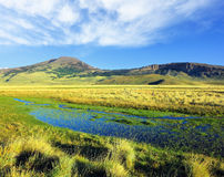 Cold creek crosses the valley Stock Photography