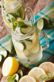 Cold cucumber lemonade with ice and mint close up in a glass jar Royalty Free Stock Image
