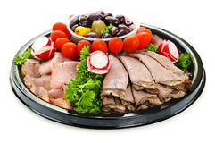 Cold cut platter. Isolated platter of assorted cold cut meat slices Royalty Free Stock Image