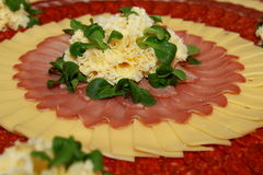 Cold cut platter with cheese and salad for decoration. Typical  Swiss cold cut platter with traditional cheese and salad leaves for decoration Royalty Free Stock Photo