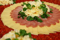 Cold cut platter with cheese and salad for decoration. Typical  Swiss cold cut platter with traditional cheese and salad leaves for decoration Royalty Free Stock Photos