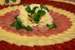 Cold cut platter with cheese and salad for decoration. Typical  Swiss cold cut platter with traditional cheese and salad leaves for decoration Stock Photos