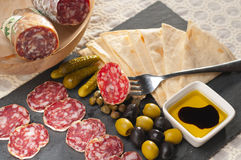 Cold cut platter with pita bread and pickles. Fresh cold cut platter with pita bread and pickles antipasti stock image