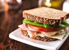 Cold cut turkey sandwich on whole wheat with swiss cheese Stock Photos