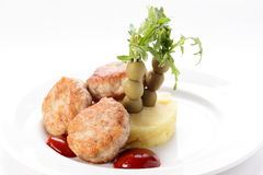 Cold cutlets with garnish Royalty Free Stock Images