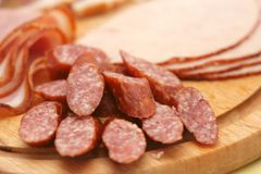 Cold cuts. Close-up of cold cuts on wood plate Stock Images
